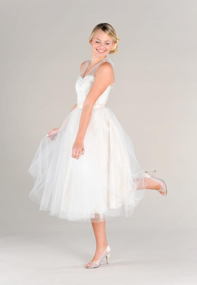 a tea length A line wedding dress with an illusion neckline, silver shoes for a modern and fun wedding look