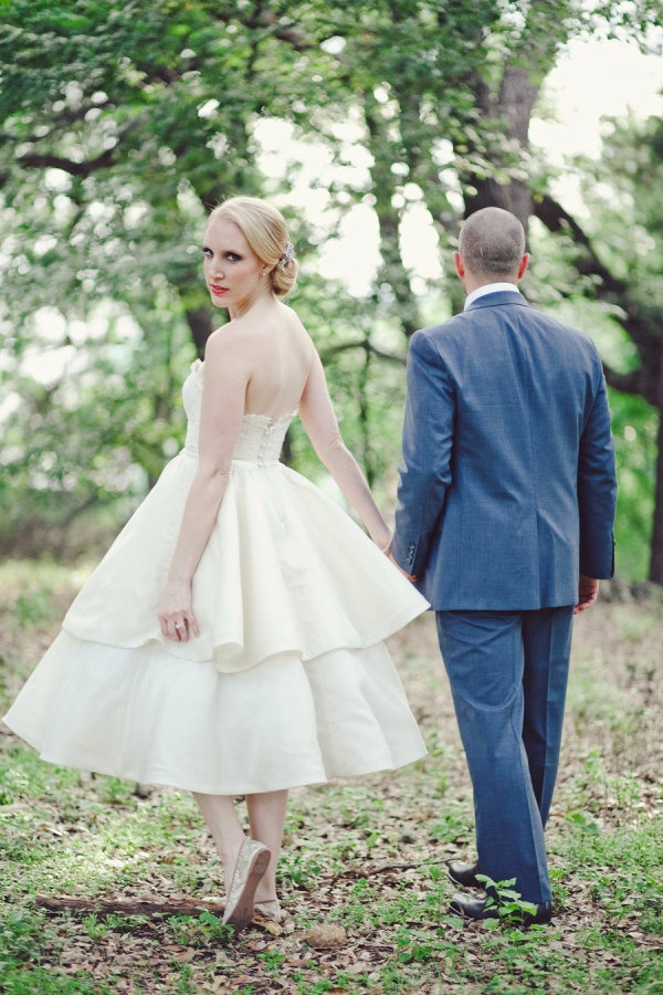 a strapless A line tea length wedding dress with a tiered skirt and a lace bodice, lace flat shoes for an elegant look