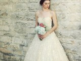 a strapless a-line wedding dress with a pleated bodice and a lace skirt, vintage shoes and pearl earrings to finish off the look