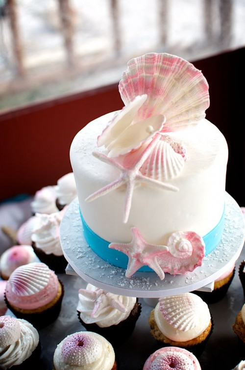 a beach bridal shower cake with seashells, starfish made of sugar looks very cool and very stylish