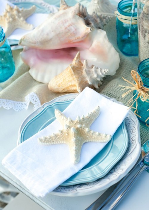 top your place settings with starfish and put seashells on the table to create a strong beach and seaside feel