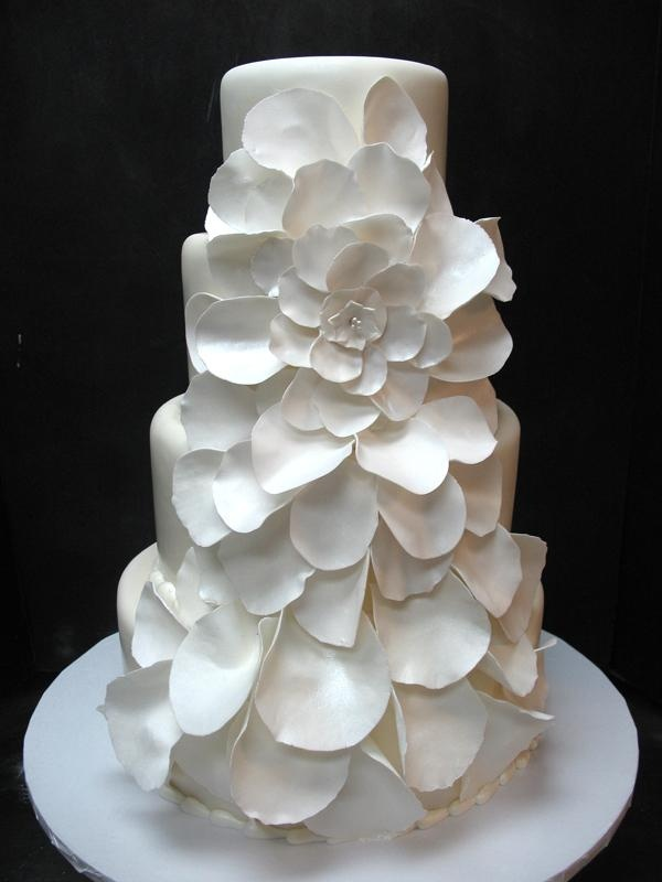 a white wedding cake decorated with white sugar blooms is a non typical and very romantic idea