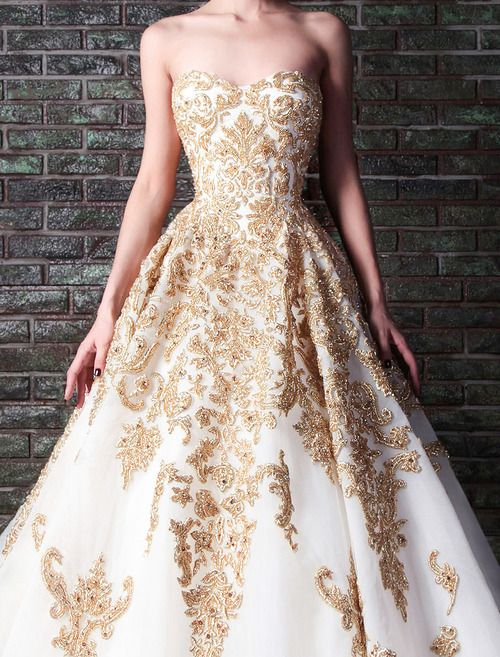 a strapless white and gold lace applique wedding ballgown is a refined and chic idea for a bride