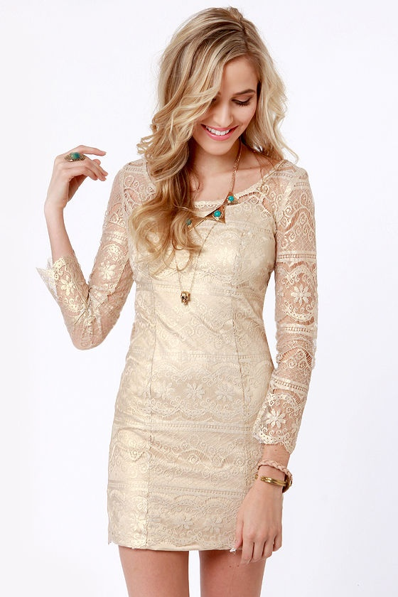 a neutral yet shiny lace mini wedding dress with long sleeves and a scoop neckline, with bracelets and layered necklaces