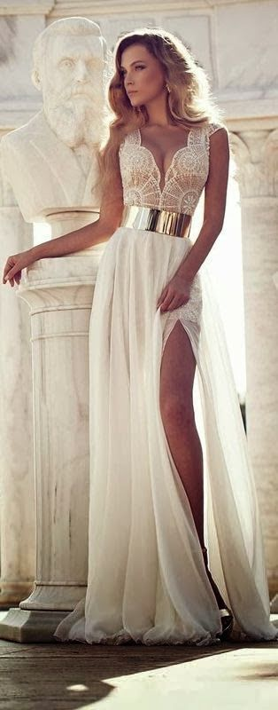 a sexy bridal look with a sleeveless wedding dress with a plunging neckline and a lace bodice, a plain skirt and a gold belt