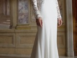 a romantic wedding dress of plain fabric and with lace inserts, a plunging neckline, long sleeves and a train