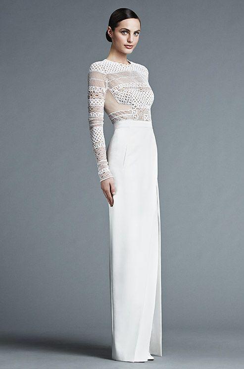 a modern wedding dress with a crochet lace bodice, long sleeves, a high neckline and a plain skirt
