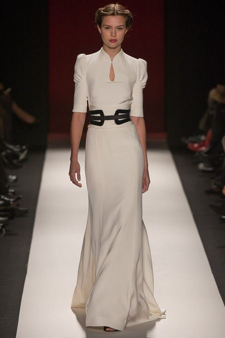 a vintage wedding dress with a catchy neckline, puff short sleeves and a black leather belt