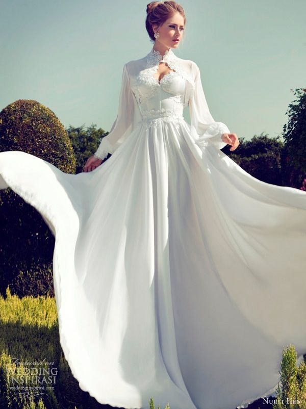 a beautiful and romantic wedding dress of plain fabric, with lace detailing, a pleated skirt and a matching coverup with long sleeves