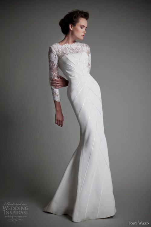 a modern and refined sheath wedding dress with a lace illusion neckline, geometric embroidery on the whole dress