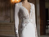 a stylish vintage wedding dress of plain fabric, with lace detailing and inserts and a plunging neckline is very sexy