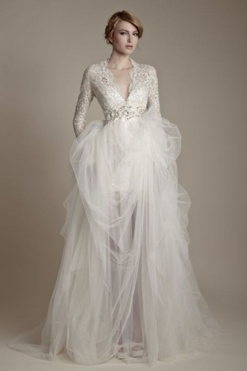 a chic winter wedding dress with a lace bodice with a V-neckline, long sleeves, an embellished sash and a layered skirt