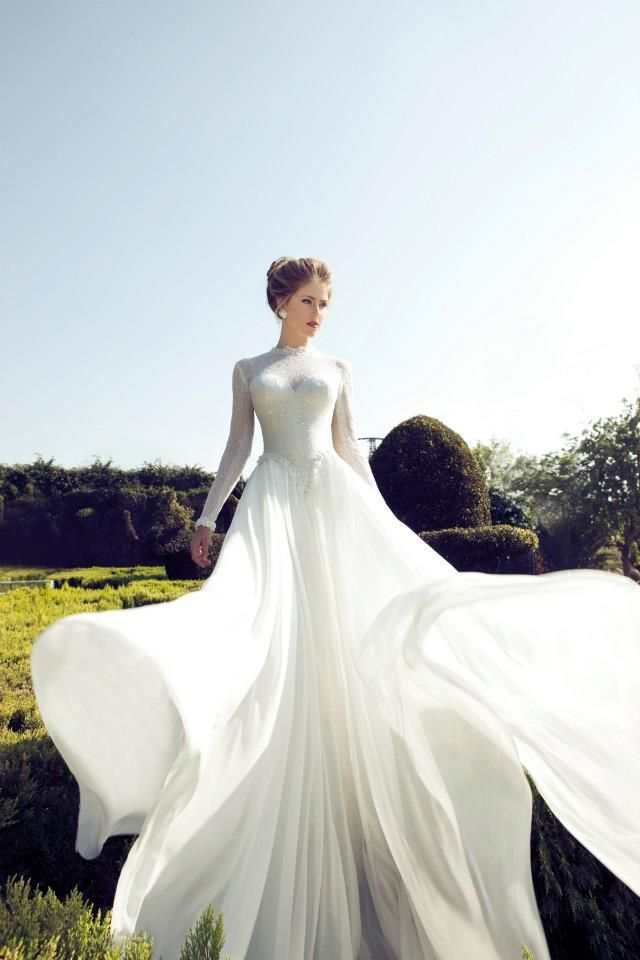 a romantic sparkling wedding dress of lace, with a high neckline, long sleeves and a train is a very refined piece