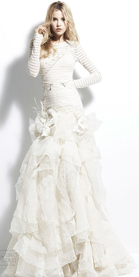 a striped wedding dress with lace detailing and flowers looks out of the box and bold