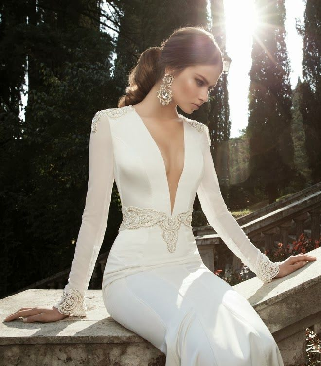 a sexy minimalist wedding dress with a plunging neckline, long sleeves and embroidery is very stylish