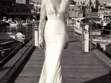 a romantic wedding dress with a lace bodice with a plunging neckline and long sleeves plus a plain skirt is a timeless idea