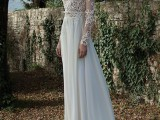 a refined winter wedding dress with a lace bodice with long sleeves and a pleated layered skirt