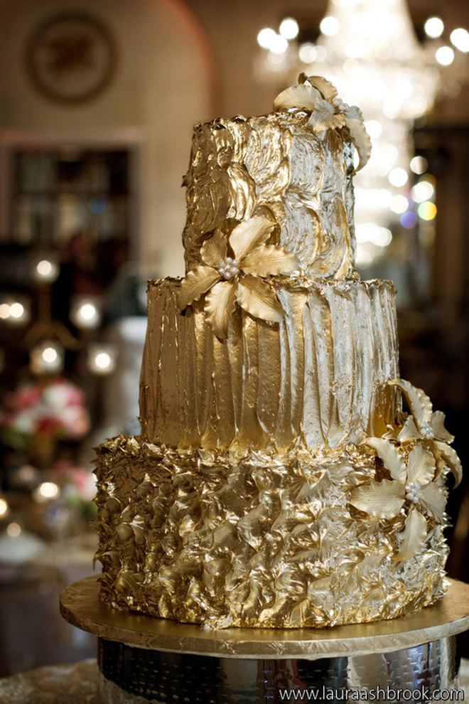 a refined textural gold wedding cake decorated with flowers and edible beading is a chic and bold dessert to rock