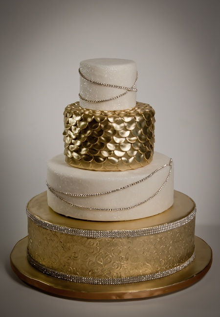 a stunning modern refined wedding cake with white and gold scale and glitter tiers and edible embellishments is wow