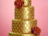 a shiny gold wedding cake with edible pearls and rust sugar blooms is a bright and refined dessert