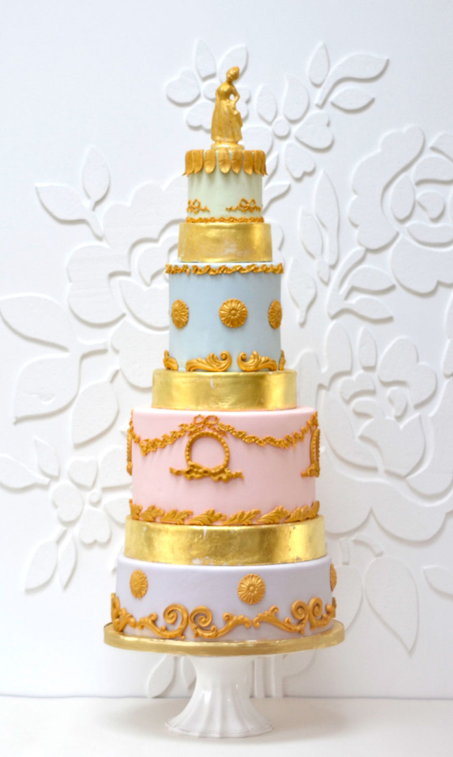 a pastel and gold wedding cake with various tiers and catchy patterns looks very chic and very stylish