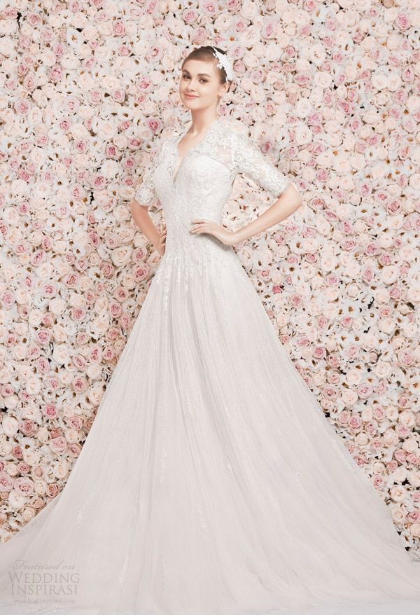 a light pink and blush floral wall backdrop is a very romantic idea for any wedding