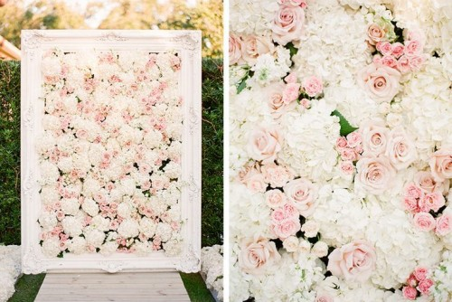 an elegant blush rose and white hydrangea floral wedidng backdrop in a vintage white frame