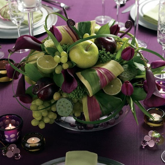 a deep purple and gree wedding centerpiece done with apples, grapes, limes for a dramatic spring wedding