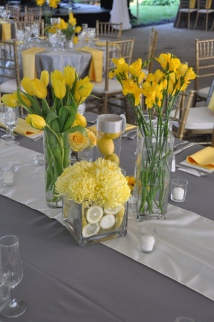 bright yellow spring wedding centerpiece with lemons are bold and cheerful for sunshine lovers