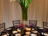 a tall white orchid centerpiece is classics that works not only for spring but also for summer and other weddings