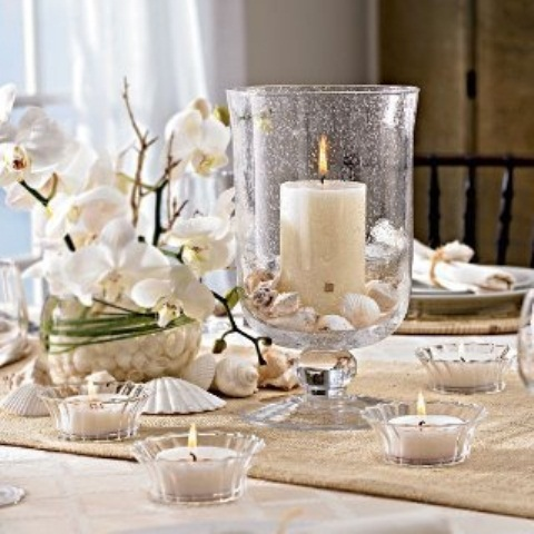 a white orchid in a pot is always an elegant and very refined wedding centerpiece, add candles