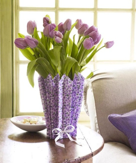 purple tulips in a vase covered with floral paper that matches are great for a spring wedding