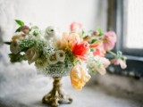 an elegant white, red and yellow floral centerpiece in a chic bowl is a cool idea for a spring wedding