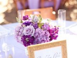 a bold lilac and purple wedding centerpiece with greenery is great for bright spring and summer weddings