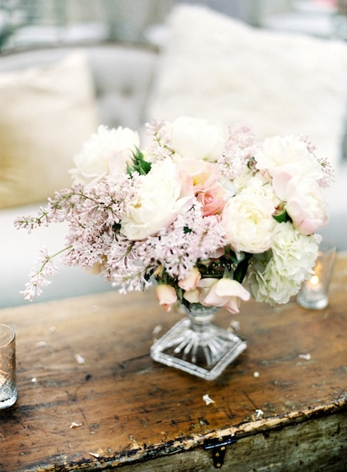 a beautiful neutral and pastel wedding centerpiece in light pink and white is a very chic and cute idea