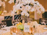 a tall pink orchid centerpiece in a clear vase is a chic and refined spring wedding ideas