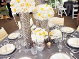 tall spring wedding centerpieces of white and yellow blooms in silver vases are cool spring wedding centerpieces