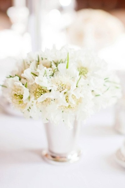 white blooms in a silver vase is classics that always works and looks very romantic