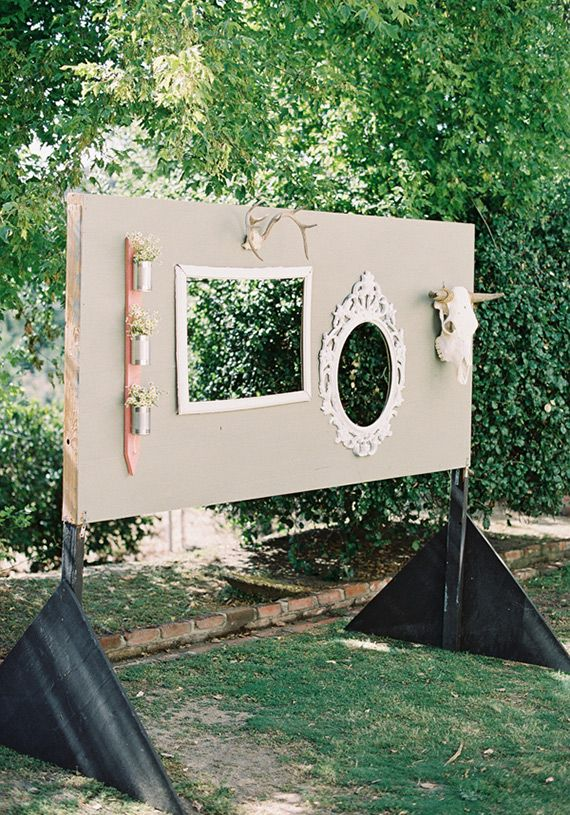 a wedding backdrop with frames of various kinds, skulls and decorations for taking pics