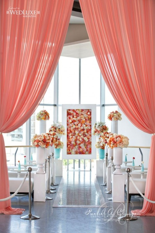 a bright bloom framed wedding backdrop is a very chic and refined idea for a wedding