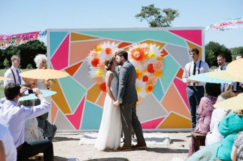 a colorful geometric backdrop will make your wedding bright, fun, whimsical and unusual