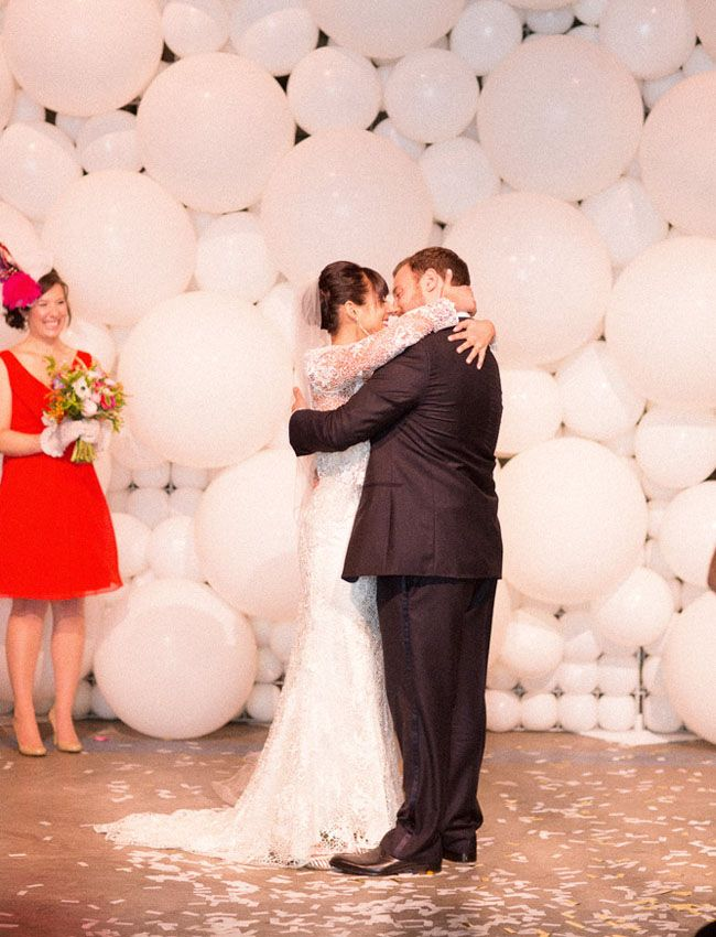 a wall of white balloons of various sizes is a gorgeously creative and fun idea with a strong party feel