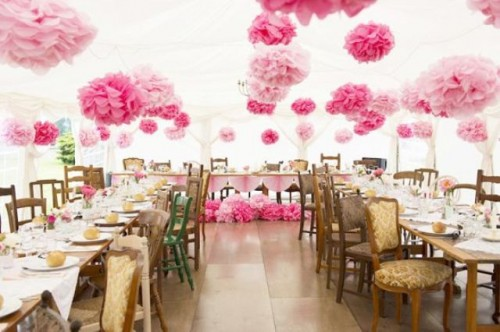 pink and blush paper balls and blooms attached to the wall and over the reception is a cool idea
