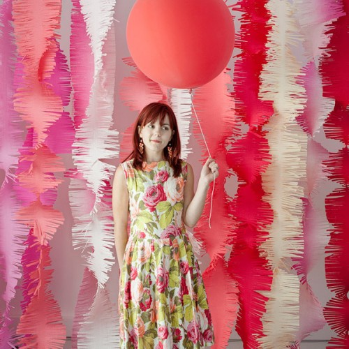 colorful fabric strips and bright balloons will make your backdrop super fun and super bold