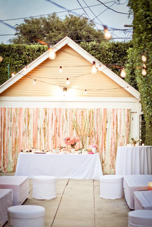 pastel and gold stripes reception backdrop with lights is a chic idea for any wedding, from glam to rustic