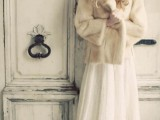 a vintage-inspired midi wedding dress and a neutral faux fur jacket are a perfect combo for a cold winter day wedding