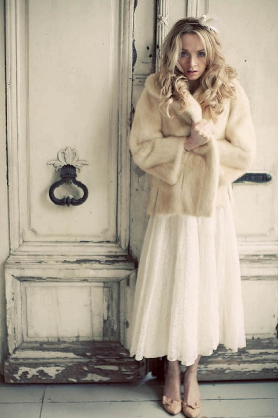 a vintage inspired midi wedding dress and a neutral faux fur jacket are a perfect combo for a cold winter day wedding