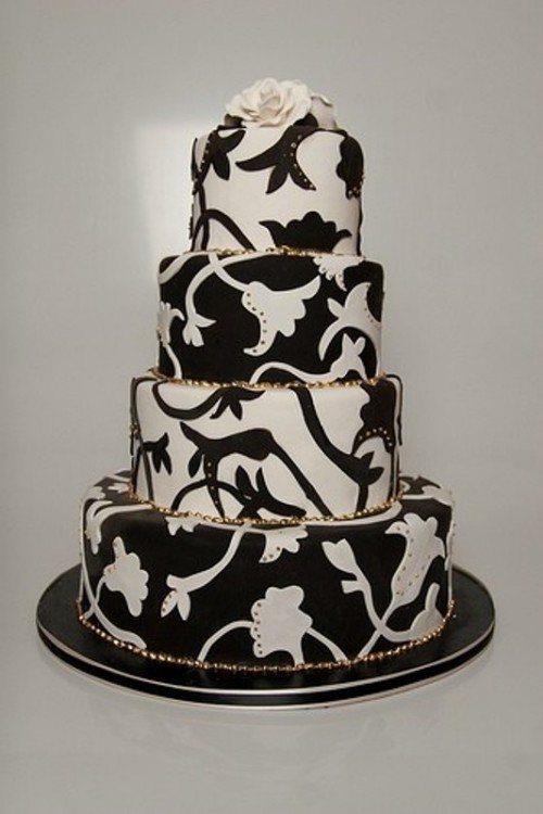 a black and white wedding cake with whimsical floral patterns is a unique and catchy idea