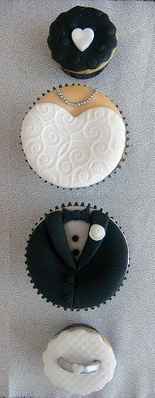black and white wedding cupcakes imitating the bride and the groom wearing a dress and a tux