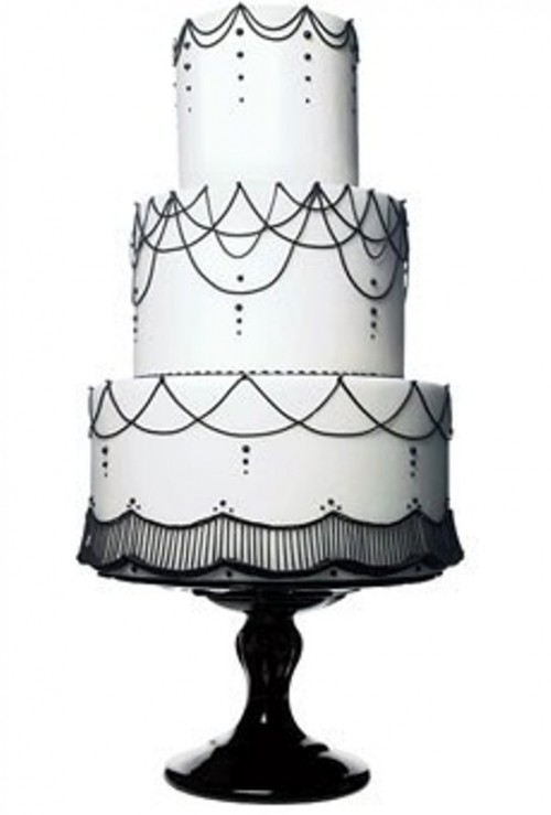 a white wedding cake decorated with black beads and patterns is a stylish and timeless idea to rock